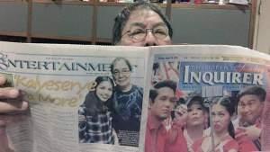 Eat Bulaga host Joey De Leon shows PDI front page  photo of AlDub.  A photo of Joey with Yaya Dub is also  featured in another part of the newspaper.