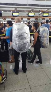 Airline passengers wrap their bags with plastic to avoid bullets being planted (by EXTORTION accomplices) that would then be DISCOVERED by security x-ray machines.
