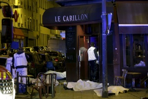 A general view of the scene that shows the covered bodies outside a restaurant following a shooting incident in Paris, France, Nov. 13, 2015.